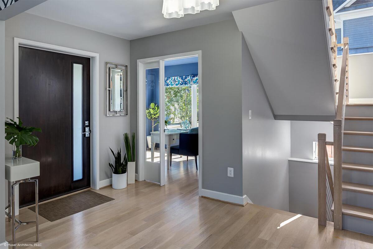 Interior pocket door entryway with contemporary front door