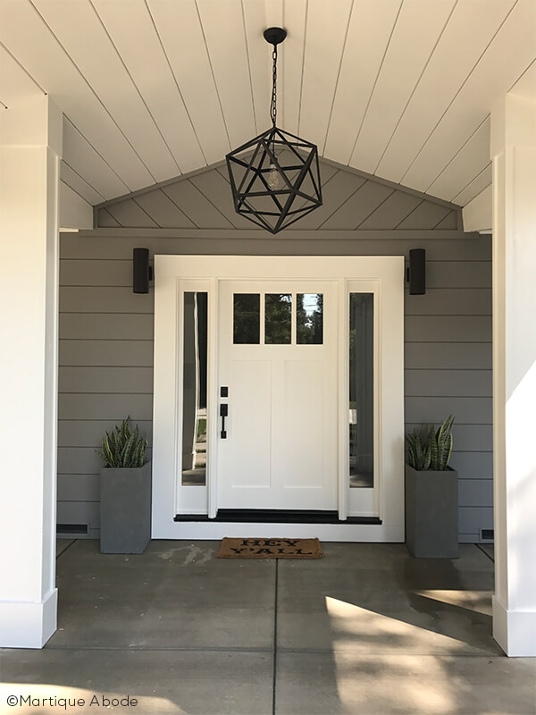 Entryway With Front Door And Sidelights