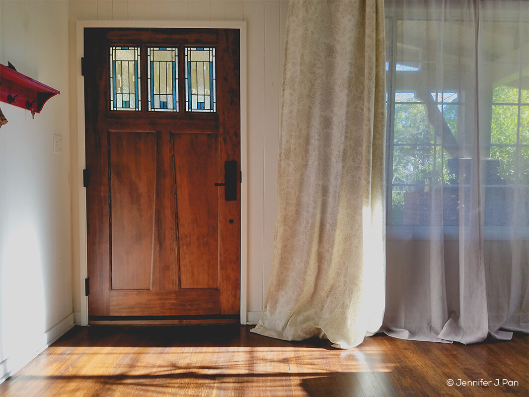 Entryway with wood front door