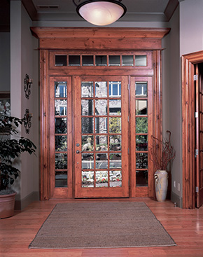 "<a mce_thref='http://www.simpsondoor.com/find-a-door/?view=detail&doorType=&BaseSpecificationID=593#DoorDetail'>7018 with beveled glass and UltraBlock® technology | shown in knotty pine with 7706 sidelights and custom transom (8'0"")</a><br /><br /><div class='social-icons'><a class='pop-up-link' mce_thref='#' data-link='http://twitter.com/share?url=http://www.simpsondoor.com/door-idea-gallery/fullsize/7018.jpg' ><img mce_tsrc='/images/icons/twitter.png' width='26' height='26' alt='Twitter' /></a>     <a class='pop-up-link' mce_thref='#' data-link='http://www.facebook.com/share.php?u=http://www.simpsondoor.com/door-idea-gallery/fullsize/7018.jpg' ><img mce_tsrc='/images/icons/facebook.png' width='26' height='26' alt='Facebook' /></a>     <a class='pop-up-link' mce_thref='#' data-link='http://pinterest.com/pin/create/button/?url=http%3A%2F%2Fwww.simpsondoor.com%2Fdoor-idea-gallery%2F&media=http%3A%2F%2Fwww.simpsondoor.com%2Fdoor-idea-gallery%2Ffullsize/7018.jpg&description=7018 with beveled glass and UltraBlock® technology 